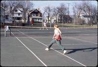 An Augsburg women's tennis team player hitting the ball backhand, April 1978