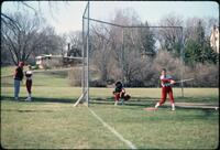 An Augsburg women's softball team player swinging at the plate, April 1978