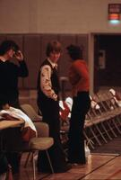Women's basketball coach talking with others, February 1978