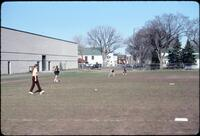 Augsburg women's softball team practicing in regular clothes, April 1978