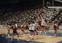 An Augsburg women's basketball team player jumping to shoot the ball, circa 1978