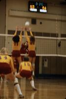 A rival volleyball team returning the ball onto the Augsburg women's volleyball team, November 1978