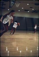 "An Augsburg women's basketball team player ""Bobby Jo"" passing the ball, March 1979"
