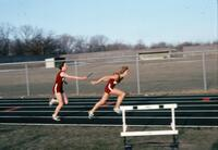 An Augsburg Women's track and field player passing the baton, April 1978