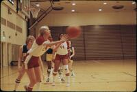 An Augsburg women's basketball team player passing the ball, February 1978