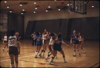 Augsburg women's basketball team at a game shooting a shot, March 1979