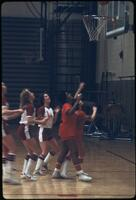 Augsburg women's basketball team trying to get the ball, March 1979