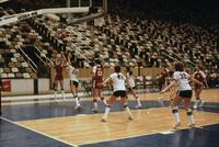 An Augsburg women's basketball team player shooting a three-point shot, circa 1978