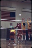 An Augsburg women's volleyball team player jumping to smash the volleyball, November 1978