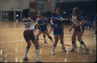 Basketball leaving the fingertips of an Augsburg women's basketball team player, March 1979