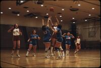 An Augsburg women's basketball team player shooting a shot, March 1979