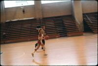 An Augsburg women's basketball team player running across the court, February 1978