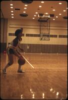 "An Augsburg women's basketball team player ""Maggie"" dribbling on the court, March 1979"