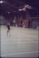 Augsburg women's tennis team players returning the tennis ball, April 1977