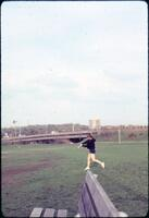 An Augsburg women's softball team player about to hit the ball, April 1977