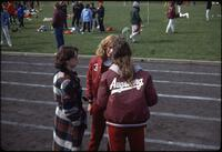 Augsburg women's track and field team runners conversing, April 1978