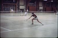 An Augsburg women's tennis team player returning the tennis ball, April 1977