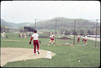 Augsburg women's softball team players practicing hitting and pitching, April 1977