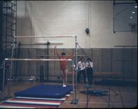 "An Augsburg women's gymnastics team member ""Carman"" in a ""ta-da"" straight stand, March 1979"
