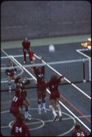 An Augsburg women's volleyball team player jumping forward to smash the ball, November 1978