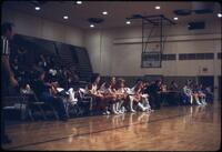 Women's basketball sitting at the sidelines, March 1979