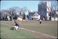 Augsburg women's softball team playing a pickup game, April 1978