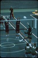Rival team player jumping and smashing the ball over the net, November 1978