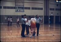 Hamline and Augsburg player talking to the referees, March 1979