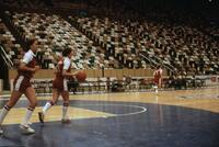 An Augsburg women's basketball team player dribbling on the court, circa 1979
