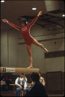 An Augsburg women's gymnastics team member standing on one leg, March 1979