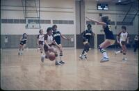 An Augsburg women's basketball team player trying to get to the other team side, February 1978