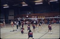 An Augsburg women's volleyball team player tossing up the volleyball, November 1977