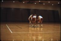Augsburg women's basketball team doing a huddle, March 1979