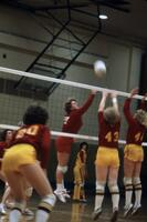 An Augsburg women's volleyball team player hitting the ball over to the other side, November 1978