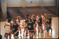 Augsburg women's basketball team shaking hands, February 1978
