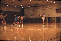 "An Augsburg women's basketball team player passing to player number ""24"", March 1979"