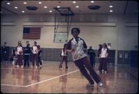 "An Augsburg women's basketball team player ""Maggie"" practicing on the court, March 1979"