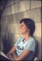 An Augsburg women's tennis team player laughing, April 1977
