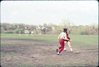 An Augsburg women's softball team player running, April 1977