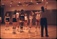 Basketball referee calling out a penalty, February 1978