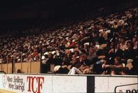 Tens of people sitting in the stadium seating, circa 1978