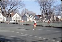 Augsburg women's tennis team practicing outdoors, April 1978