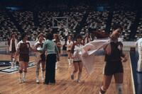 Augsburg women's basketball team walking off the court, circa 1979