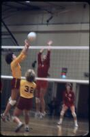 A rival team in yellow returning the ball to the Augsburg women's volleyball team, November 1978