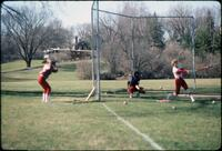 Augsburg women's softball team players practicing hitting, April 1978