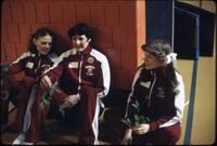 Gymnasts in their jackets laying on a wall, March 1978