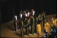 Augsburg women's gymnastics team lined up with three other teams, March 1979