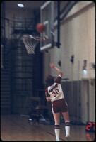 An Augsburg women's basketball team player number 30 shooting a layup, March 1979