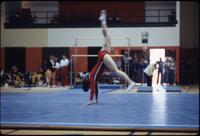 An Augsburg women's gymnastics team member raising her legs into a headstand, March 1979
