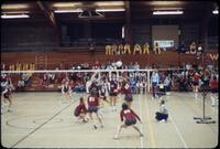 Augsburg women's volleyball team trying to block the ball, November 1977